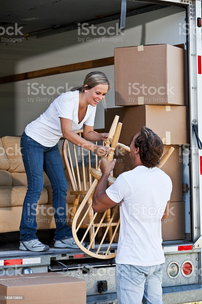 Young couple unloading moving van royalty-free stock photo