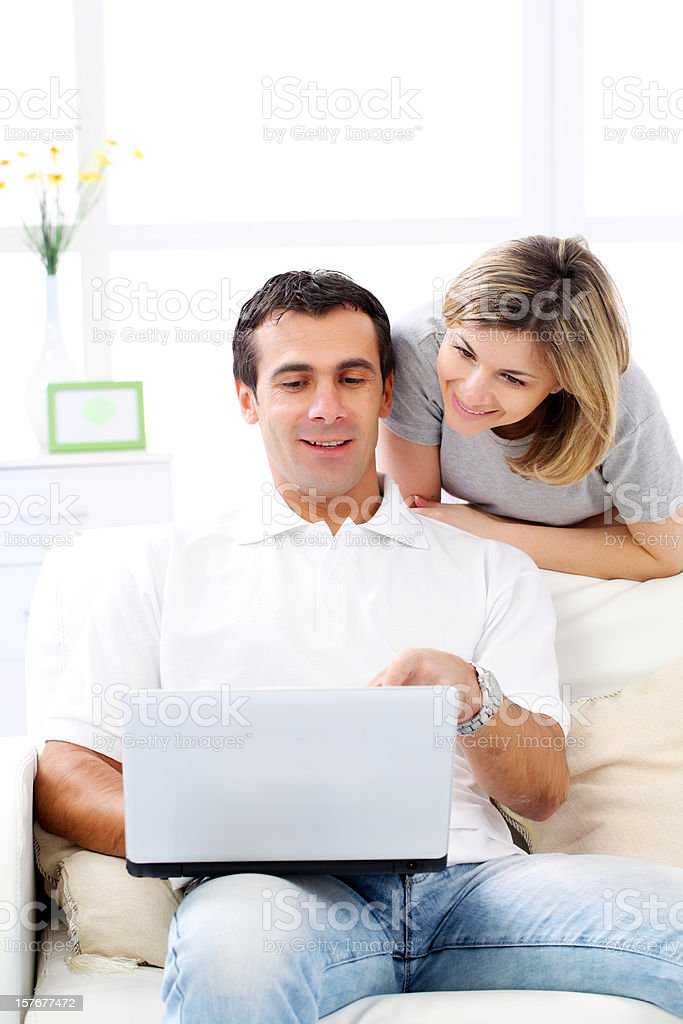 Young couple using a laptop in home. royalty-free stock photo
