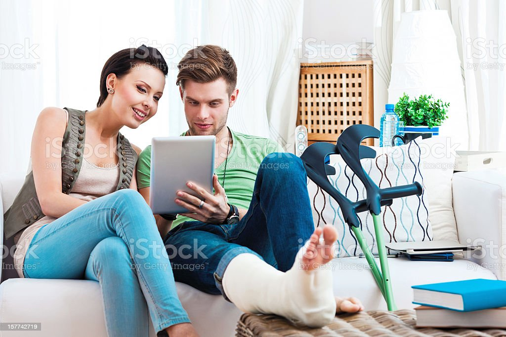 Young couple using digital tablet stock photo