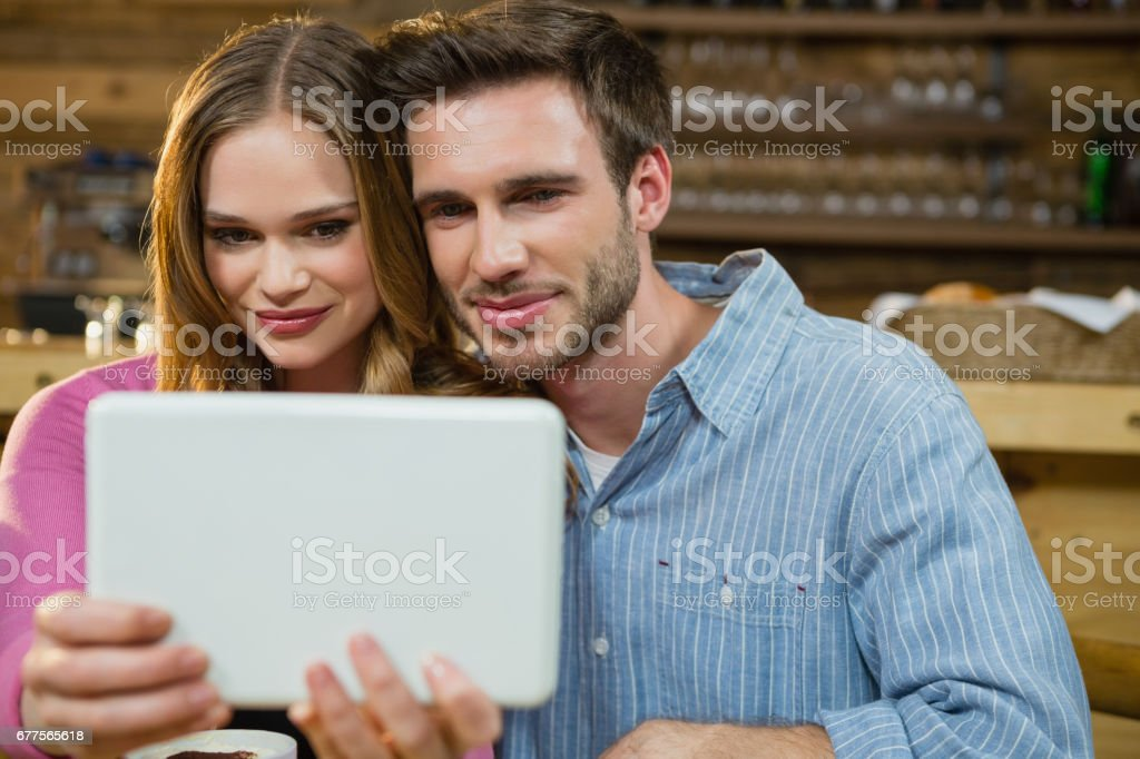 Young couple using digital tablet royalty-free stock photo