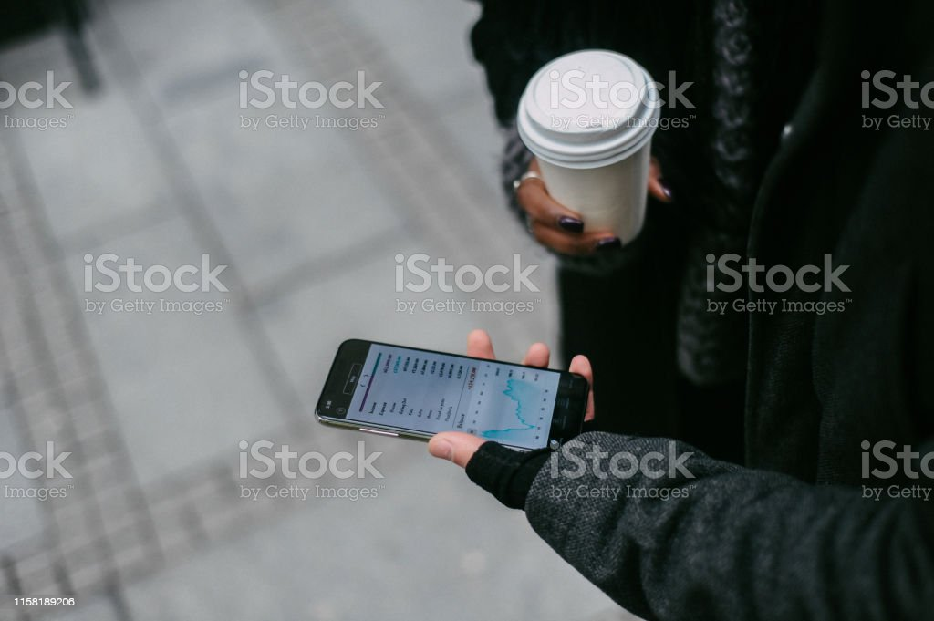 Young Couple Using Mobile Banking App Stock Photo - Download