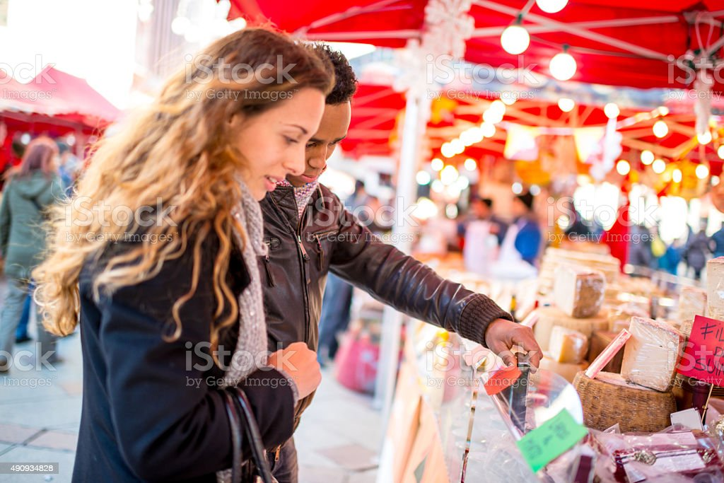 Young Couple visiting Christmas Market in Milan stock photo