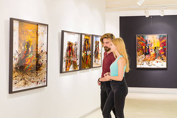 Young couple visits an art gallery stock photo