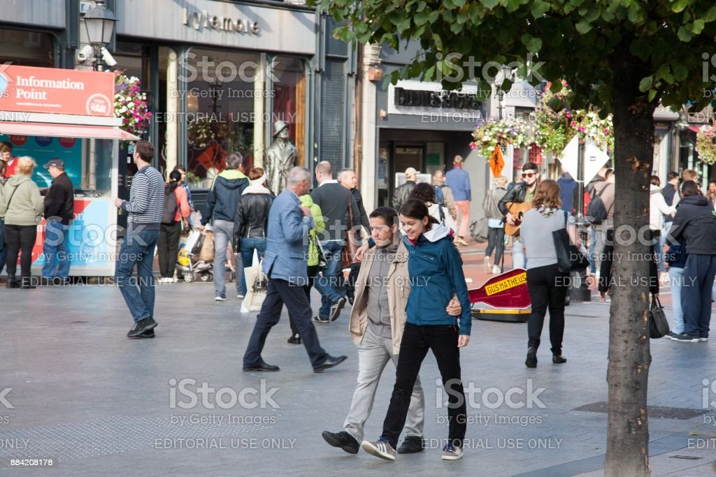 Young couple walking at O'Connell street stock photo