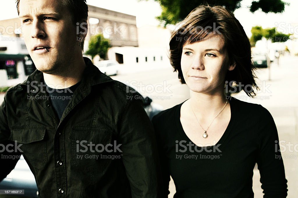Young Couple Walking Downtown in the Wind royalty-free stock photo