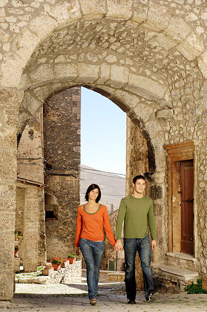 Young couple walking in a rural village stock photo