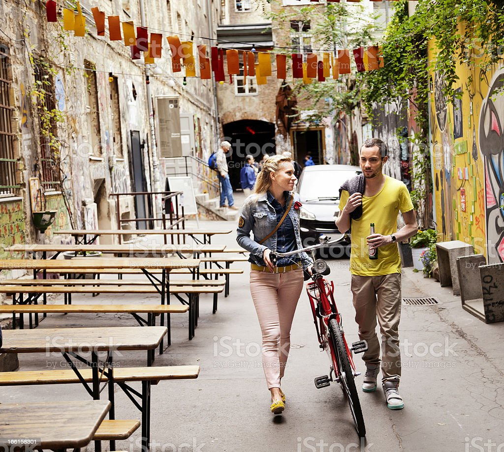 Young Couple Walking in Alley royalty-free stock photo