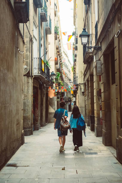Young couple walking in Barcelona old town stock photo