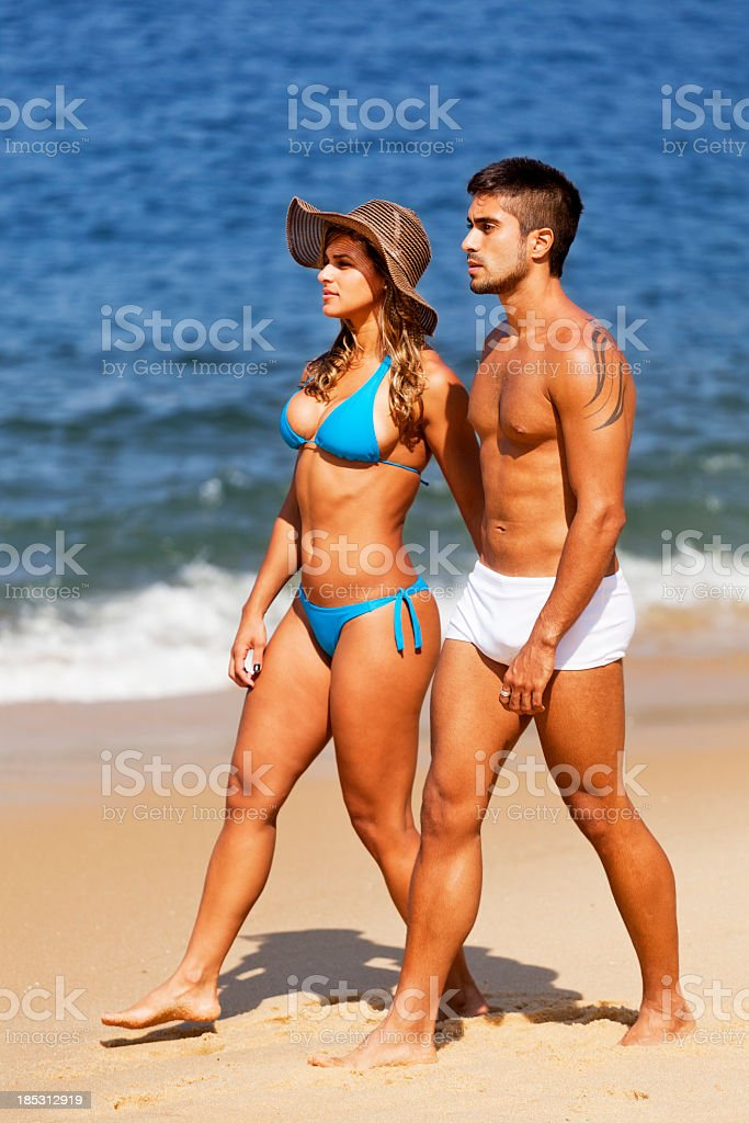 Young couple walking in the beach royalty-free stock photo