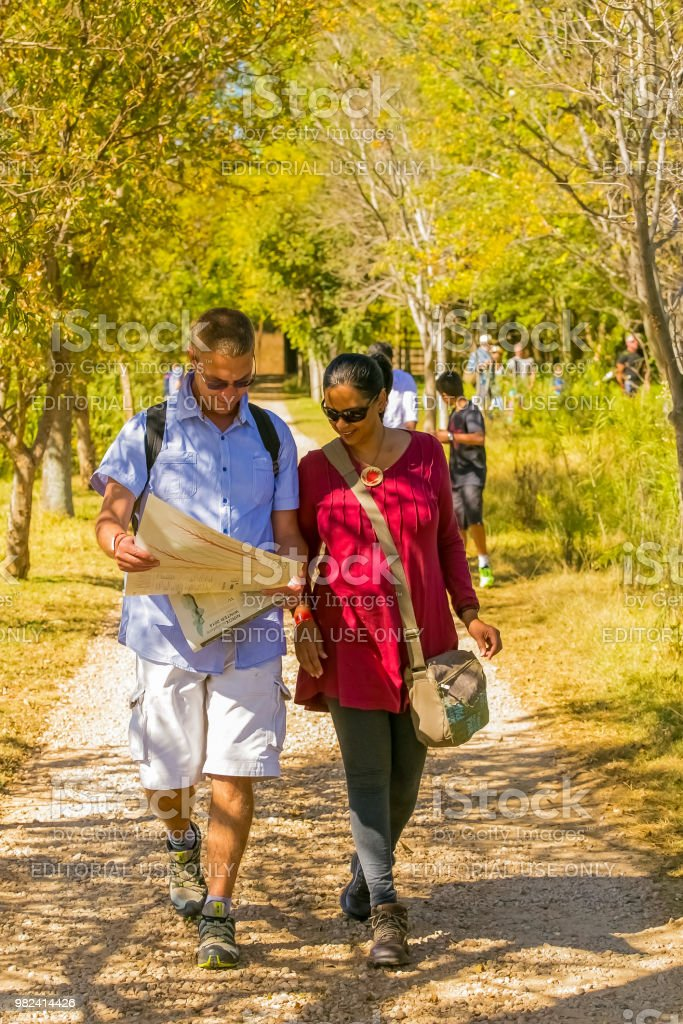 Young couple walking on a path with a map at The Winter Sculpture Fair at Nirox Sculpture Park stock photo