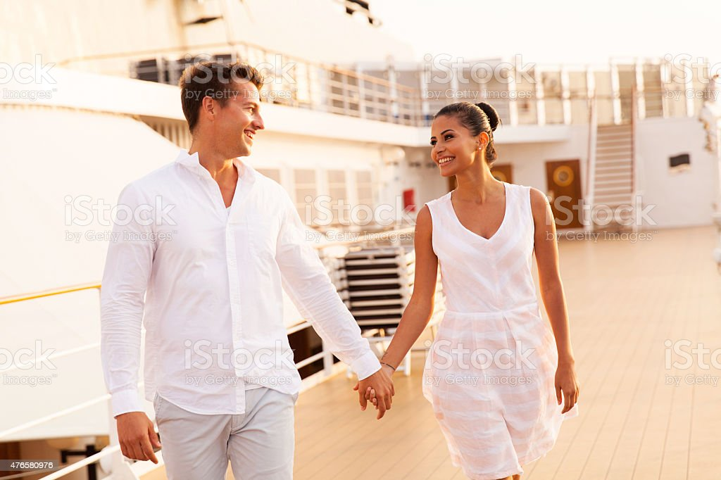young couple walking on cruise ship stock photo