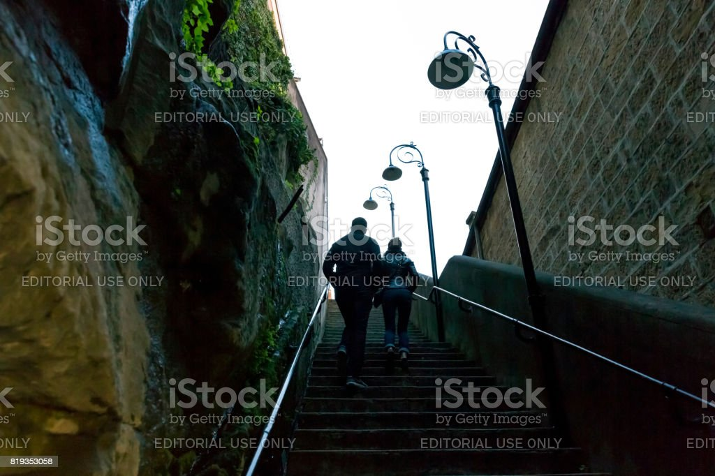 Young couple walking on old steps in The Rocks, Australia stock photo