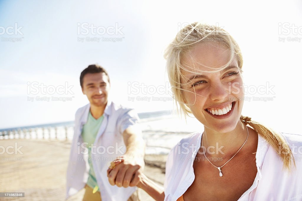 Young couple walking on the pier royalty-free stock photo
