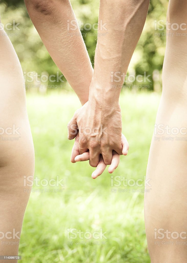Young couple walking together holding hands royalty-free stock photo