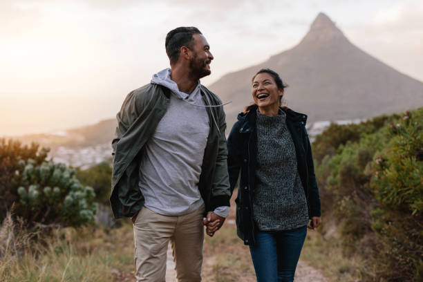 Young couple walking together in countryside stock photo