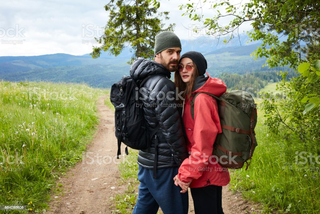 Young couple walking together in mountains royalty-free stock photo