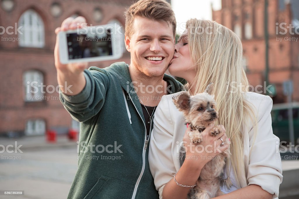 Young couple walking with their dog. royalty-free stock photo