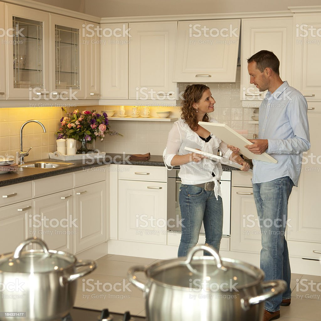 Young couple wants to buy a new kitchen in showroom. royalty-free stock photo