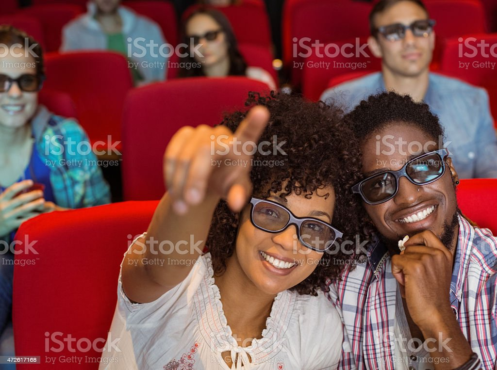 Young couple watching a 3d film stock photo