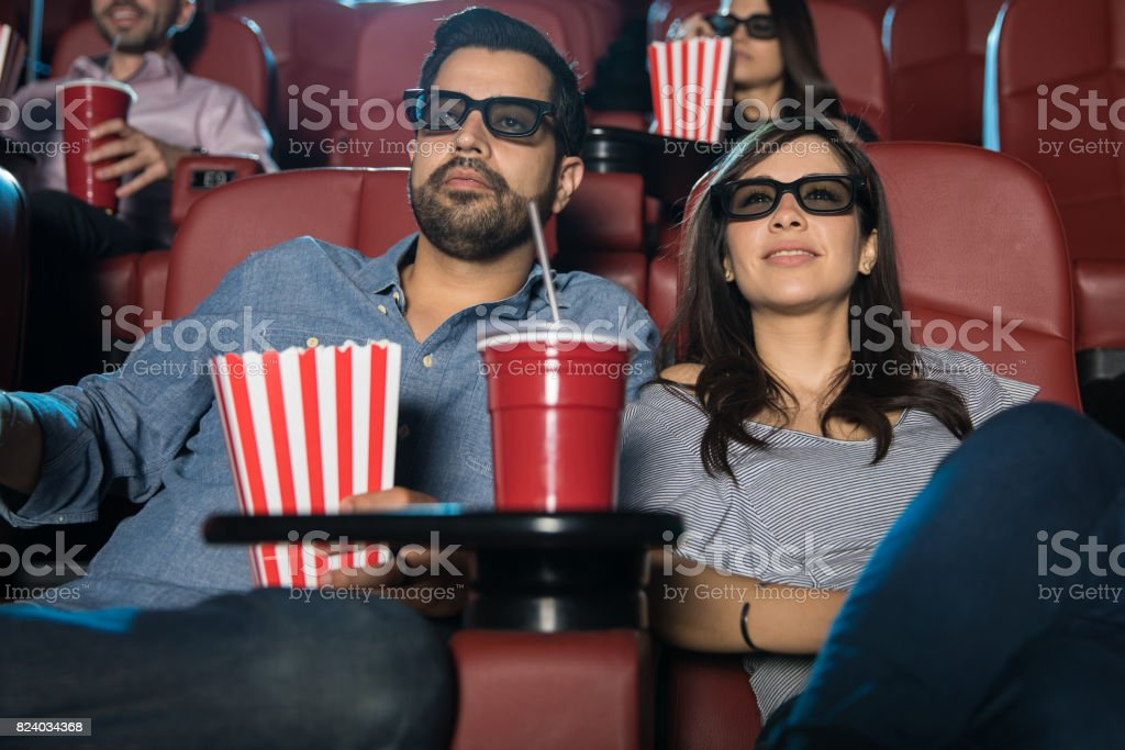 Young couple watching a 3d movie stock photo