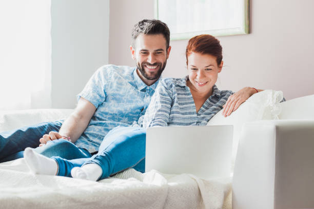 Young couple watching laptop stock photo