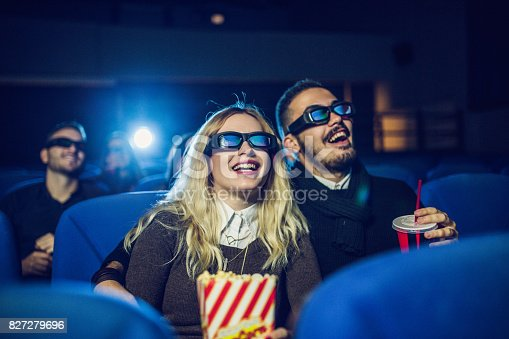 187095683 istock photo Young couple watching movie 827279696