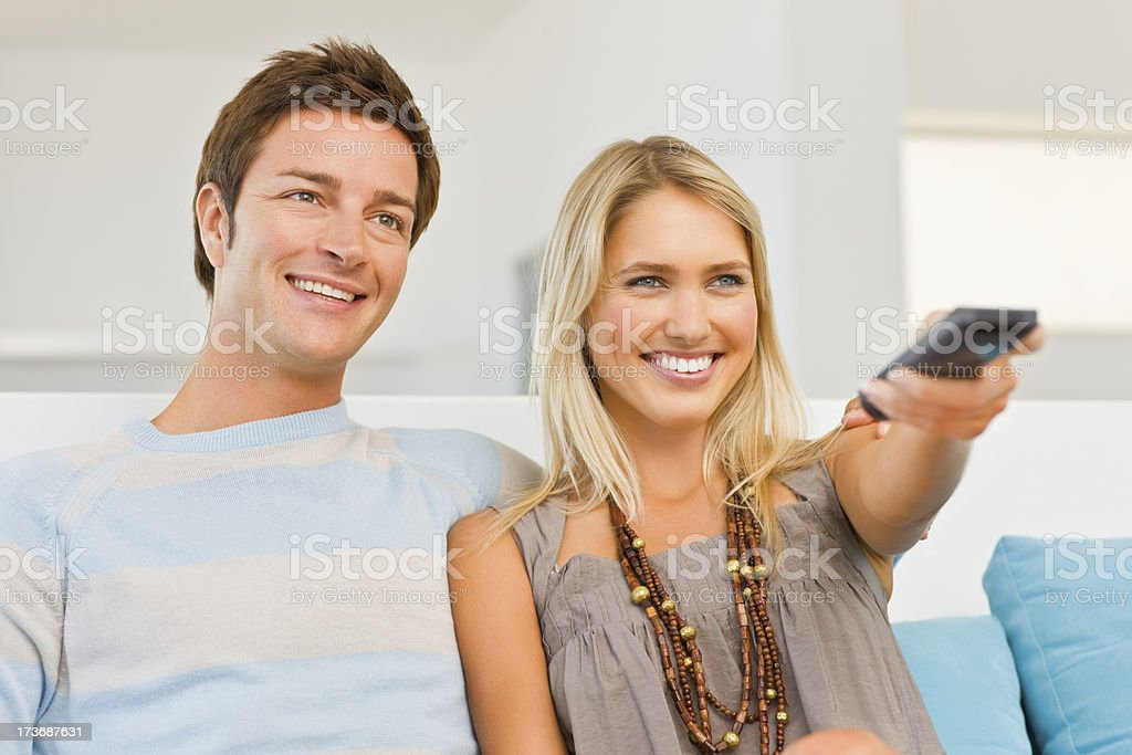 Young couple watching TV royalty-free stock photo