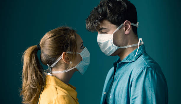 Young couple wearing a protective face mask stock photo