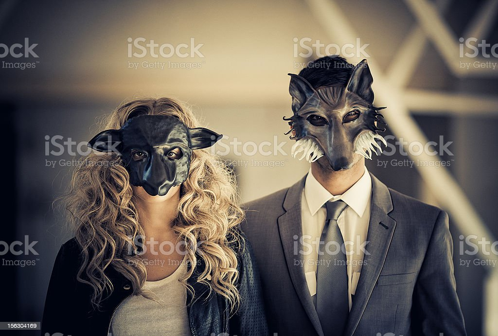 young couple wearing animal mask stock photo