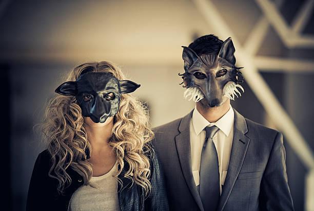 young couple wearing animal mask stock photo