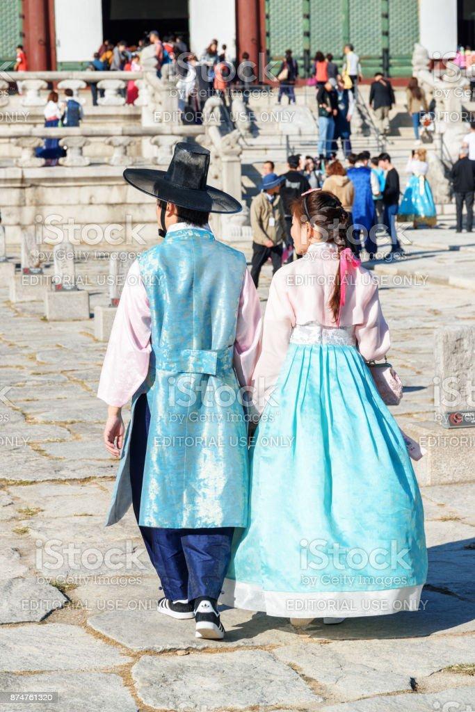 Young couple wearing Korean traditional dress, Gyeongbokgung stock photo