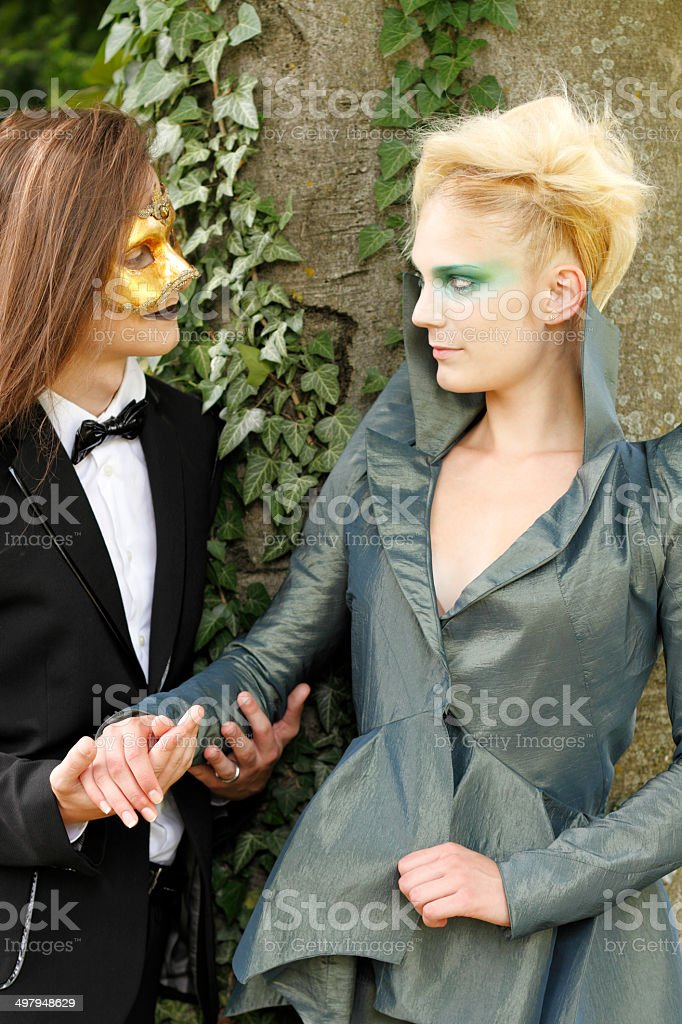 Young couple wearing masks stock photo