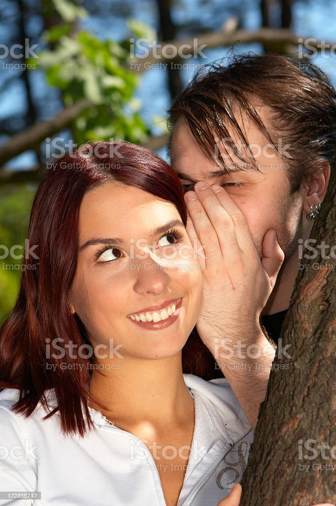 Young couple whispering royalty-free stock photo