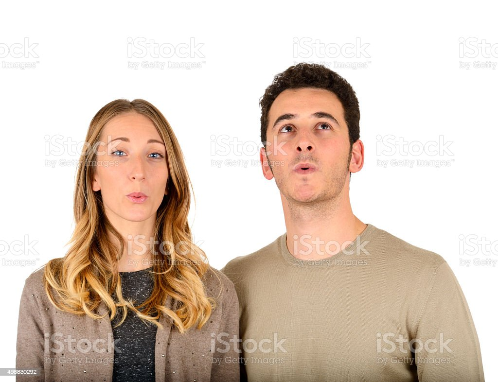 Young couple whistling stock photo