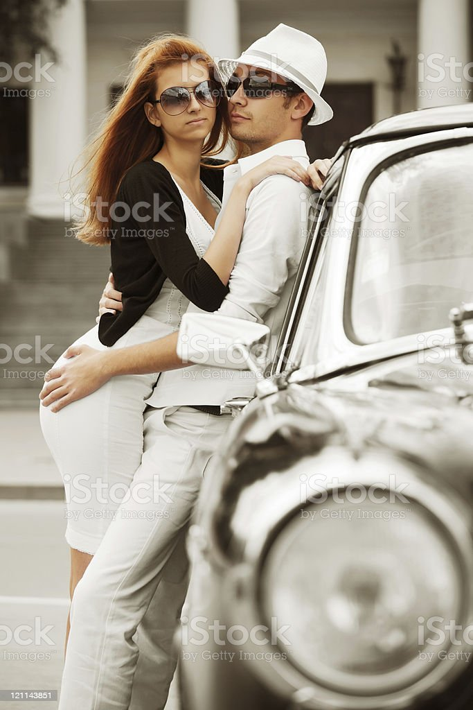 Young couple with a retro car royalty-free stock photo