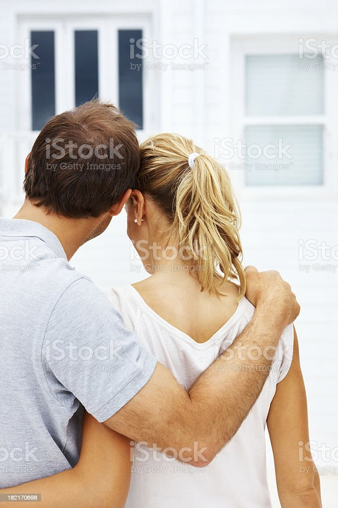 Young couple with arm around royalty-free stock photo