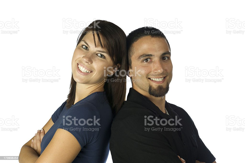 young couple with backs together royalty-free stock photo