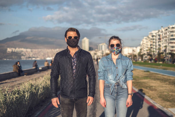 Young couple with Face Masks stock photo