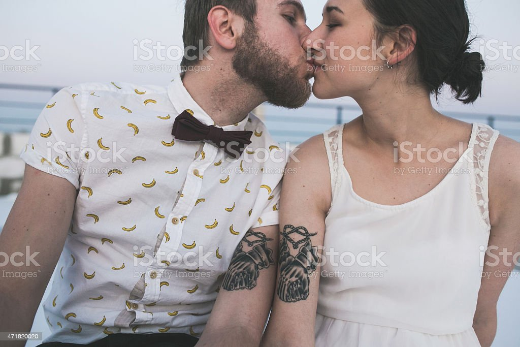 Young couple with matching tattoos and styles stock photo