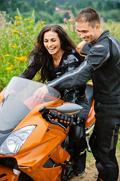 young couple with motorbike stock photo