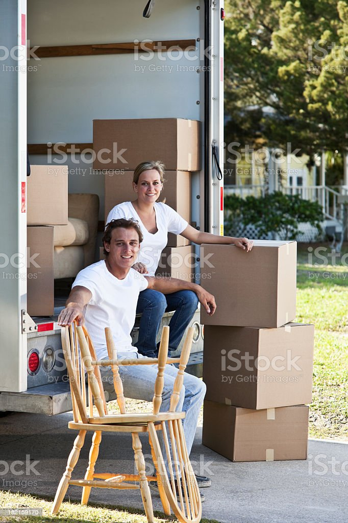 Young couple with moving truck royalty-free stock photo