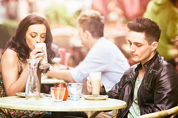 Young couple with nothing left to say Young couple on a bad date in a Berlin cafe. The man looks disappointed and serious, on the verge of announcing a break-up. bad date stock pictures, royalty-free photos & images