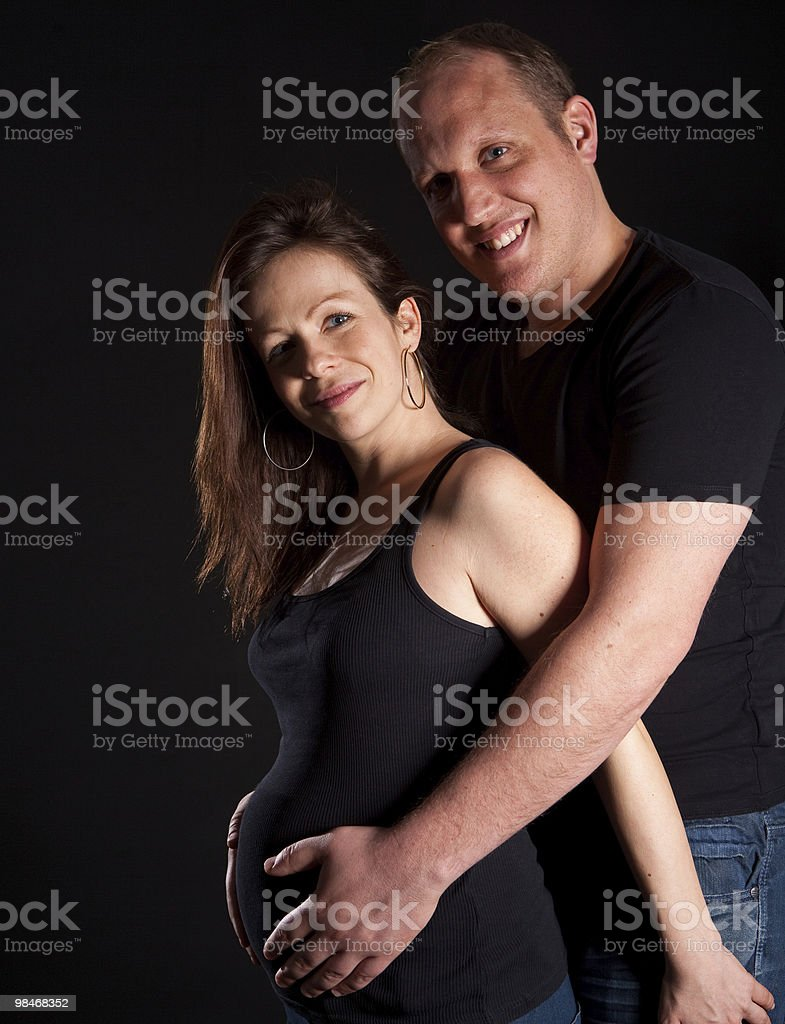 Young couple with pregnant wife royalty-free stock photo