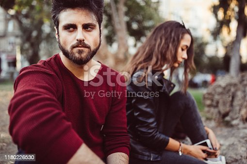 Couple outside not talking to each other after conflict
