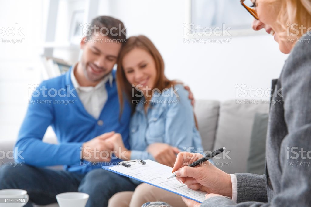 Young Couple With Psychologist Family Therapy Therapist
