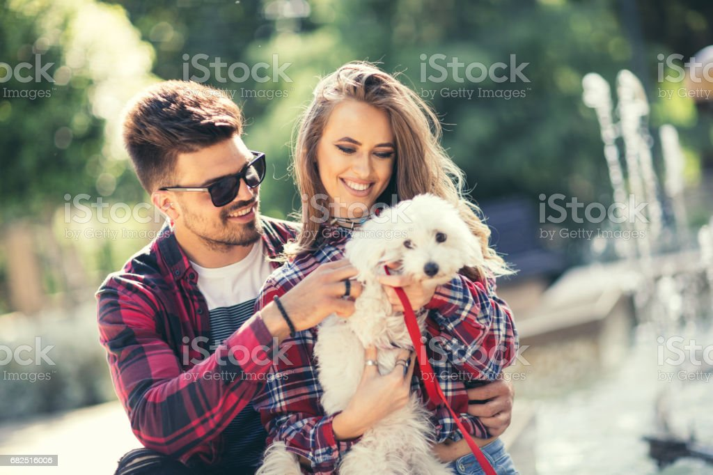 Young couple with puppy royalty-free stock photo