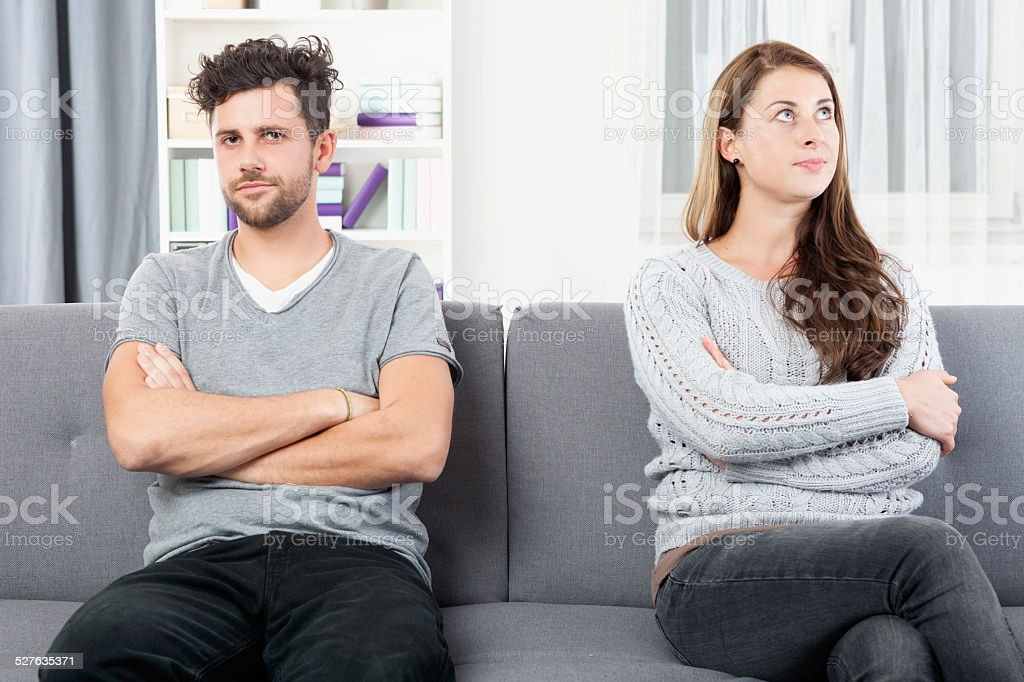Young couple with relationship problems, annoyed by each other stock photo