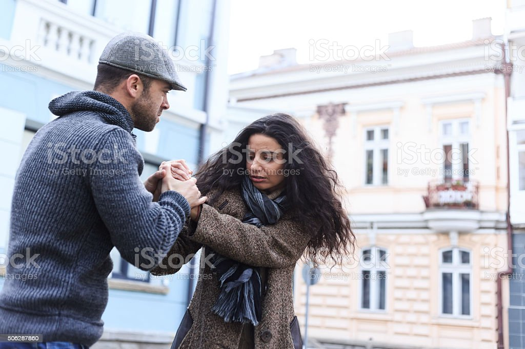 Young couple with relationship problems on street stock photo