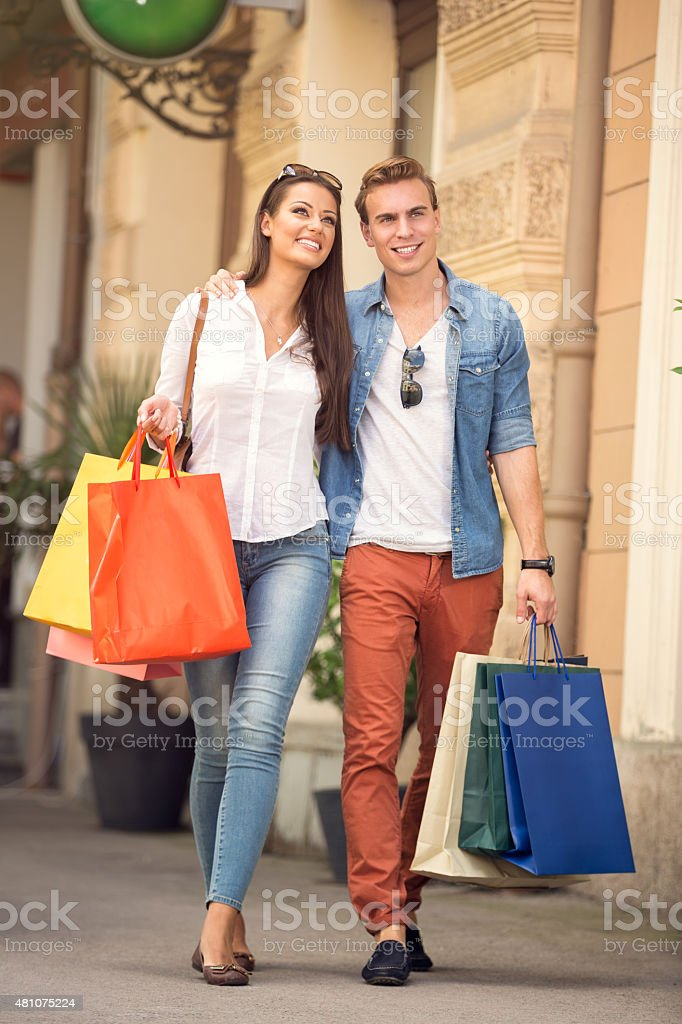 young couple with shopping bags - Royalty-free 2015 Stock Photo