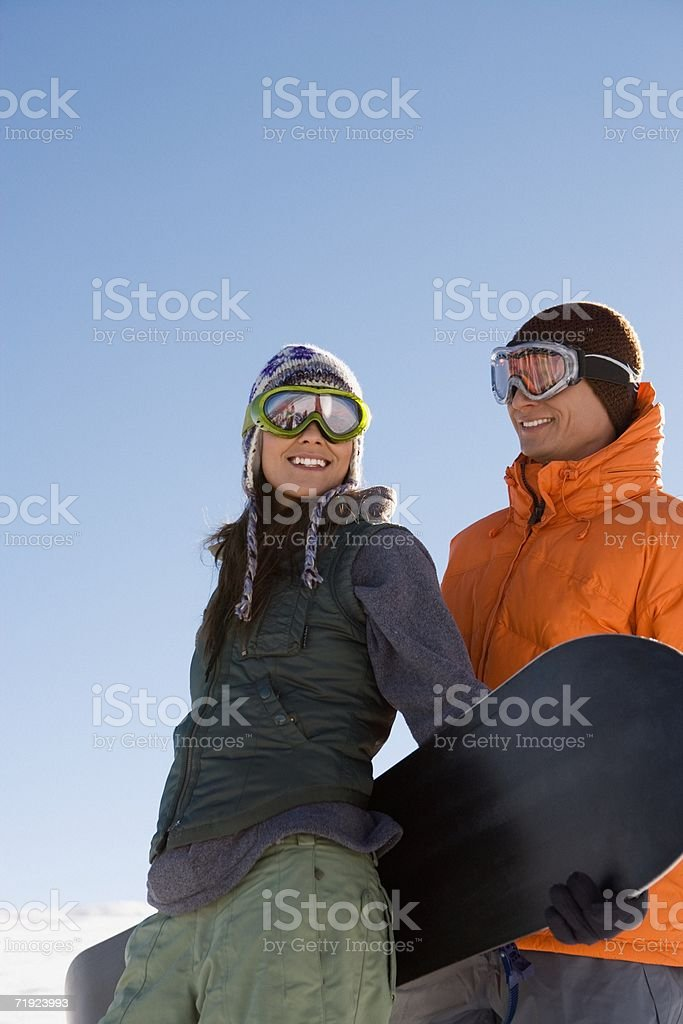 Young couple with snowboard royalty-free stock photo